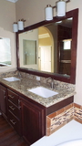Granite Vanity with Europa Under-mount Sink & Wood Trimmed Mirrors